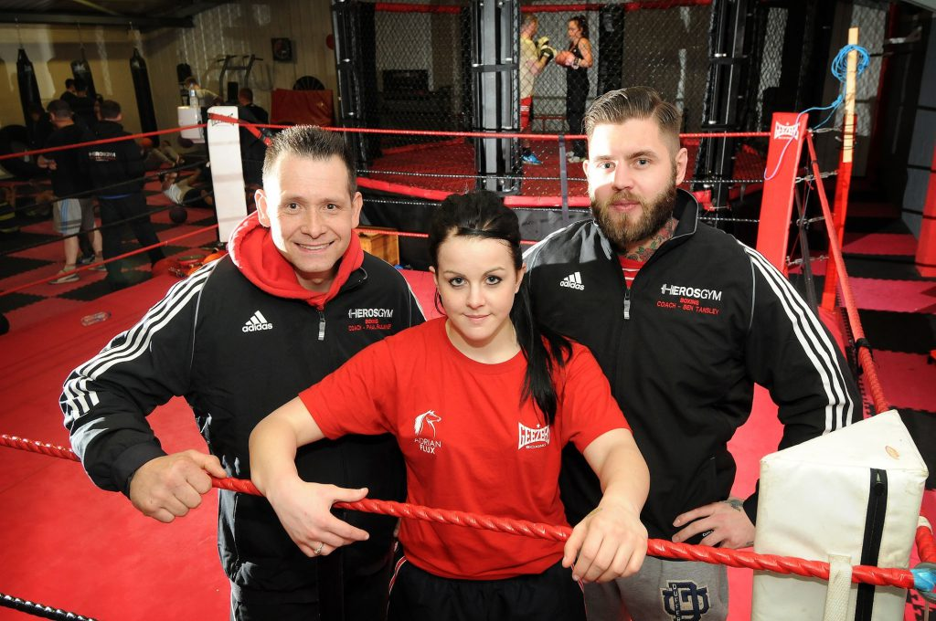 Left to right (copyright Lynn News): Coach Richard Girdlestone, Stevi-Ann Levy and Ben Tansley, coach and owner of Heros Gym.