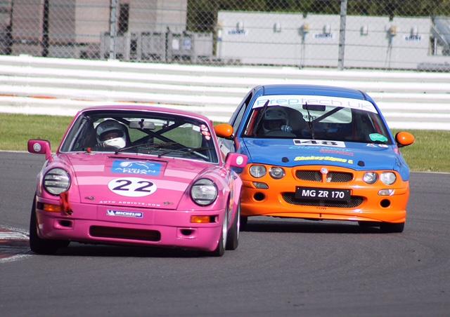 The Porsche holds off an MG