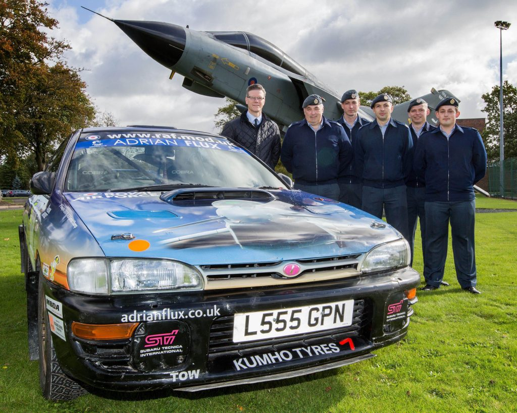 RAF Typhoon Rally Team in front of the RAF Marham gate guard Left to Right: Adrian Flux Craig Darwin and RAF members (front row) CT Chris Daykin, Cpl Guy Bentley, SAC(T) James Hollis; Back Row SAC(T) Lewis Lawes, SAC(T) Ben Church.