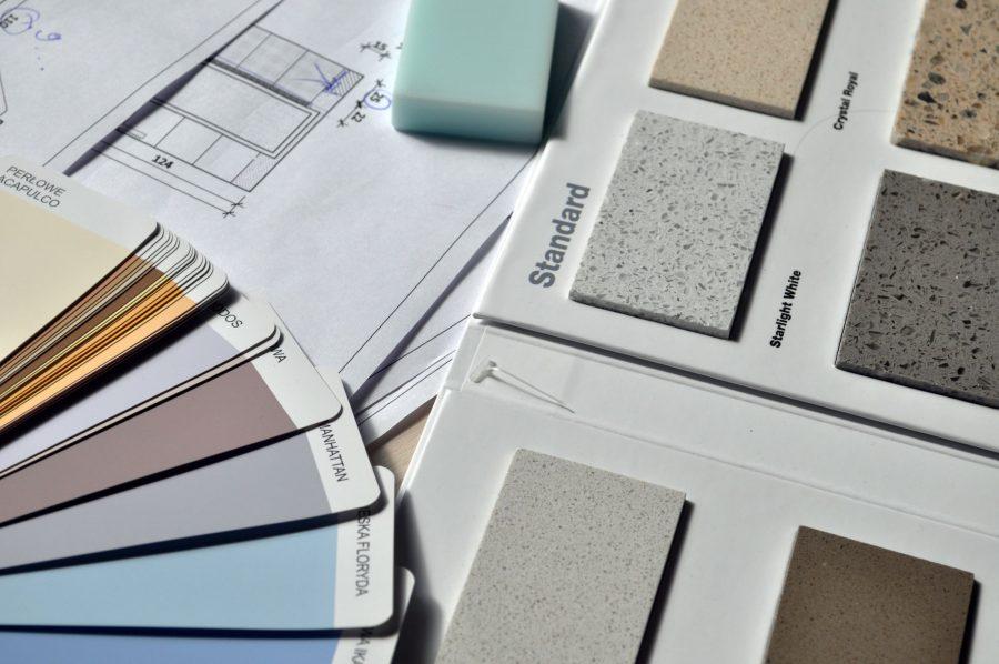 Grey standard colour book near green eraser