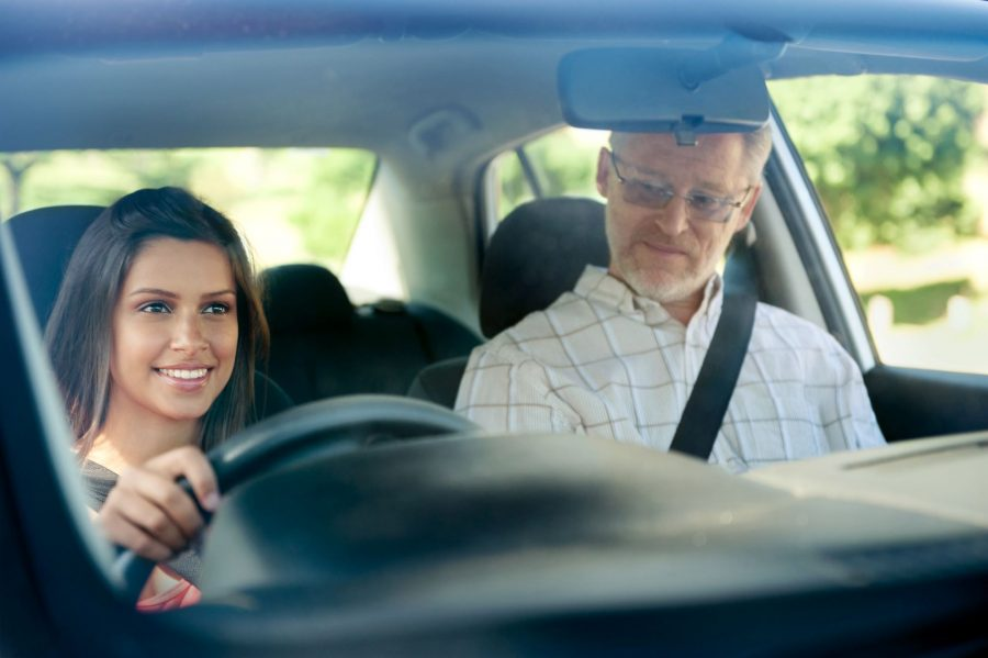 Young confident woman learning to drive
