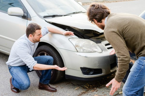 Two people arguing after a car accident