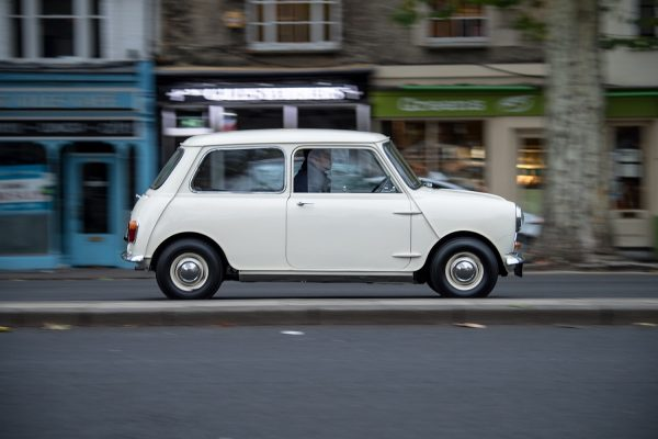 White Morris Mini Minor racing through the streets