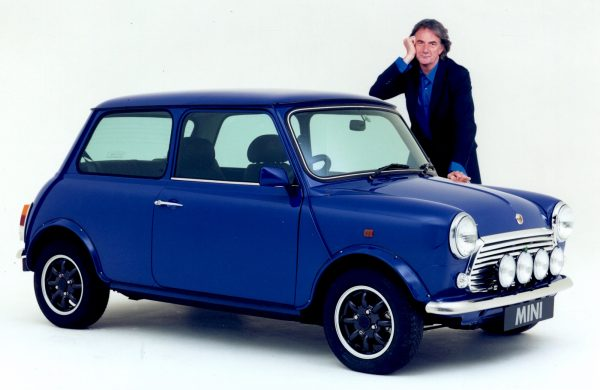 Paul Smith posing with a blue Mini