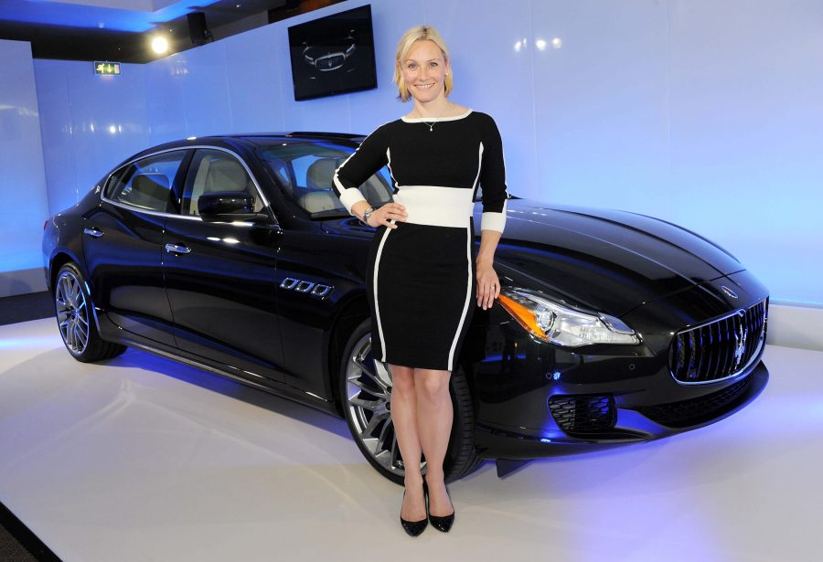 Vicki Butler-Henderson in front of a shiny car