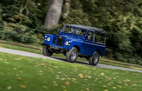 Land Rover racing along the road