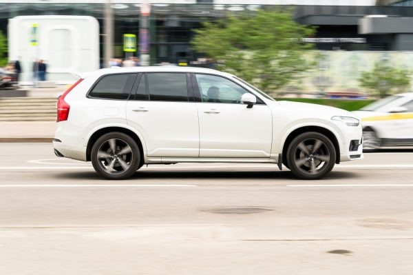 The Volvo XC90, an AWD, speeding along a road