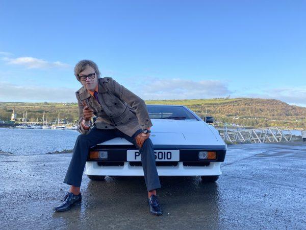 Alex Riley sits astride a Lotus Esprit