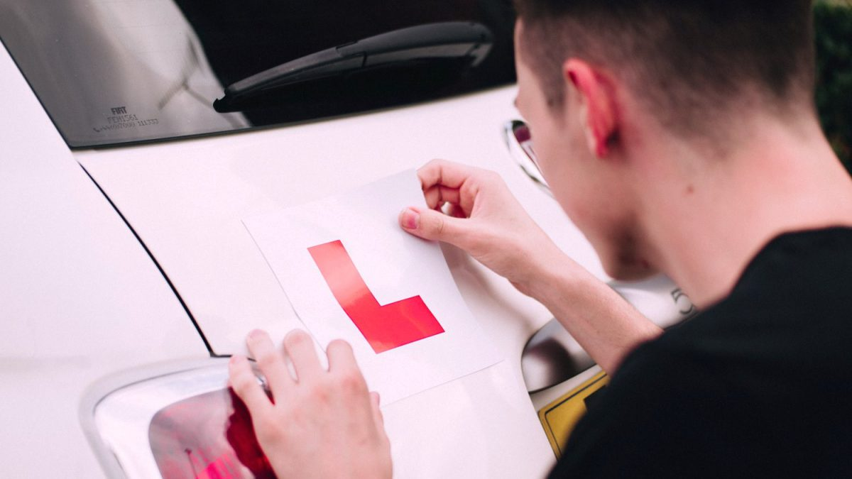 Putting L plates on car after failing driving test